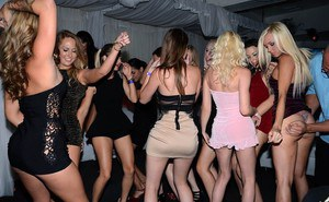 Hot chicks in short dresses opt for a full blown orgy inside nightclub