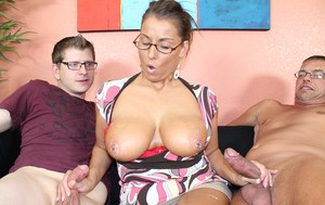 Big titted 40 plus lady Stacie Starr jerks off her husband and stepson at once