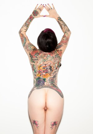 Ink Queen Joanna Angel removes black bikini to model in the nude