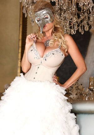 Blonde chick Kelly Madison releases her big tits from her white gown