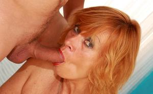 Older redhead holds her small tits together for a cumshot after fucking
