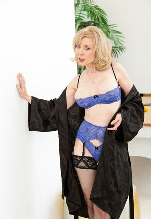 Hot older woman Nina Hartley in sexy lingerie seducing some young cock
