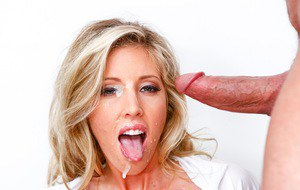 Buxom nurse Samantha Saint in fishnet stockings gets cum facial from patient