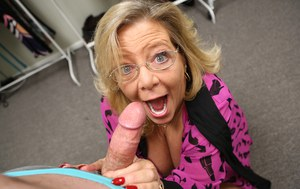 Blonde granny Karen Summers jerks on a cock in POV mode with her glasses on