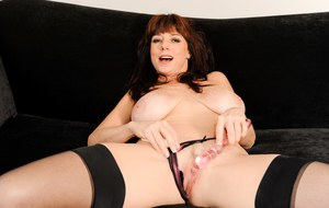 Hot mature lady Karen Kougar unleashes her nice melons a as she undresses