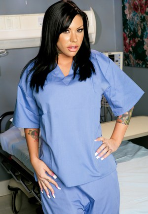 Latina chick with black hair and tats takes off her scrubs to pose in lingerie
