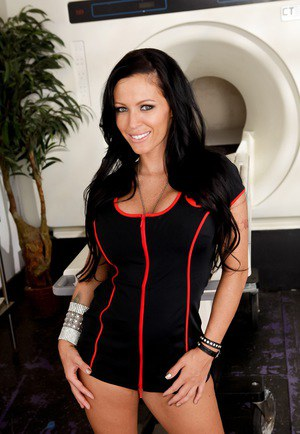 Clothed female Jenna Presley poses in naughty nurse attire and red boots