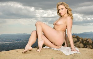 Natural blonde Mia Malkova removes blouse and lingerie on hill overlooking sea