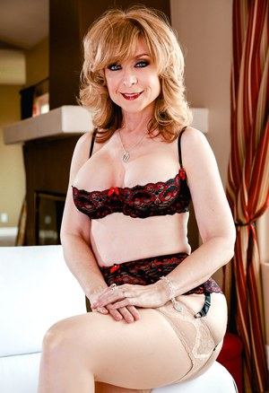 Hot mature Nina Hartley in sheer stockings spread naked & lifting legs high
