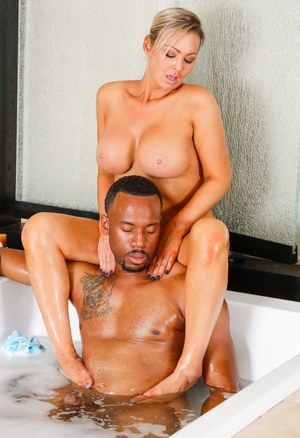 Busty masseuse Abbey Brooks wears cum on face after satisfying a black client