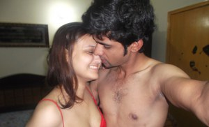 Desi couple enjoys watching themselves having foreplay in a mirror