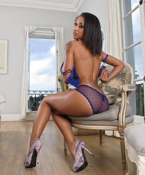 Sexy Latina Skin Diamond in sheer lingerie stuffing her ass with a glass plug