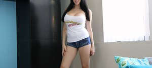 Dark haired amateur Kayla Kiss unveils her huge breasts in denim shorts