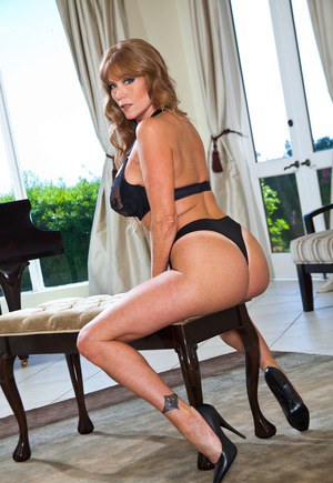 Sexy mature Darla Crane in high heels undressing to pose in lace lingerie