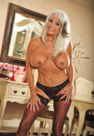 Hot older MILF Sally Dangelo unleashes her fun bags while disrobing