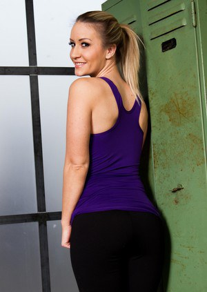 Sol model Candice Collyer takes off her tank top to model in spandex pants
