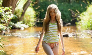 Petite teen plays naked in the river showing teeny tiny tits  hot little ass