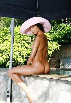 High heels wearing slut Olga M oiled  posing naked outdoors by the pool