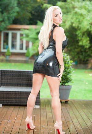 Blonde bombshell Dannii Harwood shows off her bare legs in a latex dress