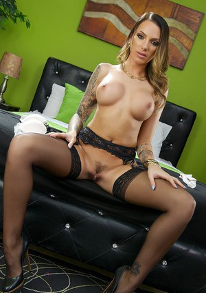 Tattooed slut Juelz Ventura offers huge big tits while spreading in stockings