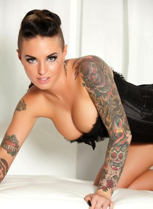 Top pornstar Christy Mack poses in a black bustier and matching thong