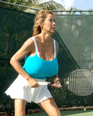 Top heavy Asian lady Minka bounces her hooters while playing tennis