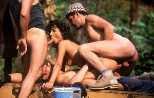 Erotic Lulu takes on three foresters for a vintage outdoor cock sucking 3some
