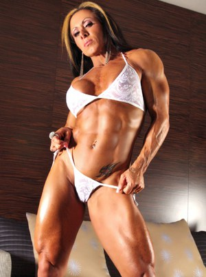 Female bodybuilder Monica Martin displays her muscled physique in a bikini