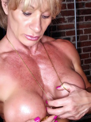 Bodybuilder Kathy Connors plays with her nipples after removing bikini top
