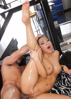 Hot Asian chick Asa Akira gets oiled up prior to a hard fuck
