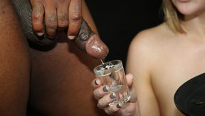 White slut fills shot glasses with cum from big black cocks during a gangbang