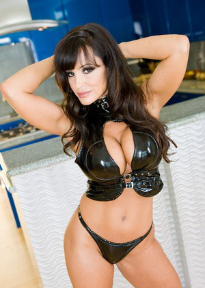 MILF pornstar Lisa Ann performs a double penetration in black heels