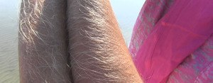 Amateur chick Lori Anderson shows off incredibly hairy forearms by the water