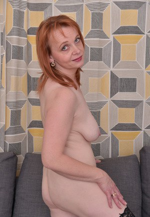 European housewife confidently strips to her mesh stockings