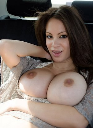 Hot Talia Shepard bares her huge tits  drops her shorts to finger in the car
