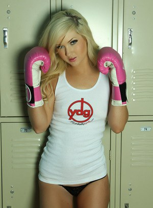 Sexy blonde model Ashlie Madison covers up her boobs with pink boxing gloves