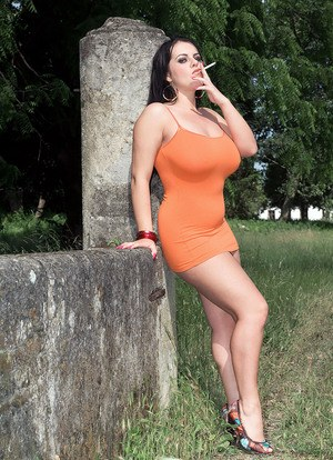 Bold sexy Mandy Pearl pauses for a smoking break and a quick big tit tan