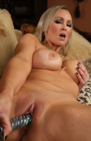 Blonde solo girl Abbey Brooks sticks a dildo in her wet pussy