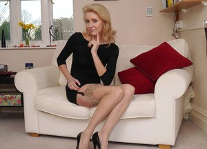 Older blonde Magdalena in sheer nylons and high heels has a secret foot fetish