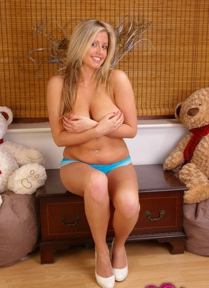 Hot blonde Emily Brady in shorts teasing with her naked big boobies