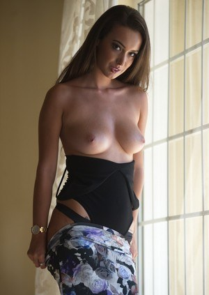 Solo girl Lauren Louise lets her boobs fall free from her bodysuit