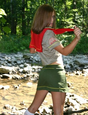 Naughty teen girl teases next to a stream in her Girl Guides uniform
