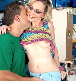 Hot mature in glasses Diandra loses her top to expose her tiny breasts