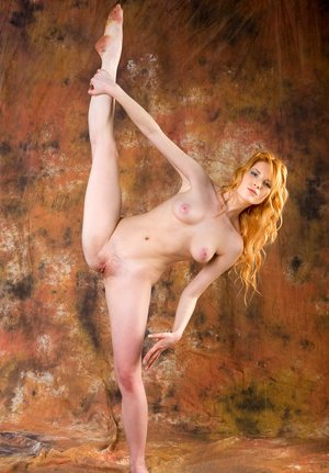 Flexible hot redhead Rosalia stretches legs and provides hard nipples closeup