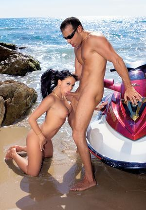 Stunning dark haired Cristina Bella gets her hot ass fucked on the beach