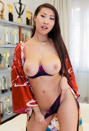 Busty hot Asian Sharon Lee spreading her shaved pussy and ass wide for photos