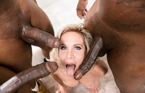 Top pornstar Nadia North does a hardcore triple penetration with black men