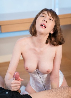 Lovely Japanese girl in white corset giving the most spectacular handjob ever