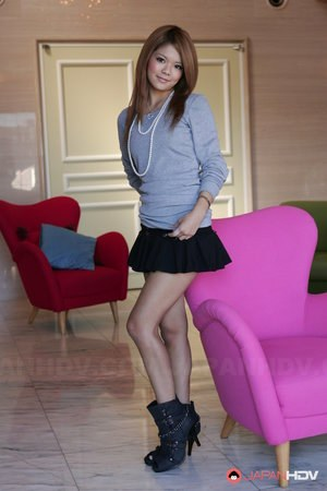 Beautiful Asian model Kanon flashes hot upskirt while posing in short skirt