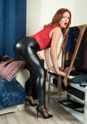 Kinky model Eva Berger dons sheer pantyhose over latex pants, arms & head